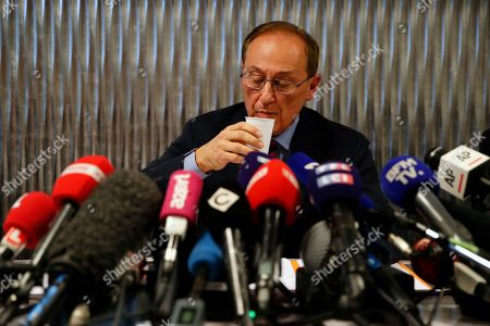 French Ice Skating Federation (FFSG) president Didier Gailhaguet takes a drink as he speaks to the media during a press conference in Paris,. Gailhaguet faces media questioning after refusing to resign, despite being asked to by Sports Minister Roxana Maracineanu after figure skater Sarah Abitbol and another skaters accused their former coach Gilles Beyer of rape when they were teenagers