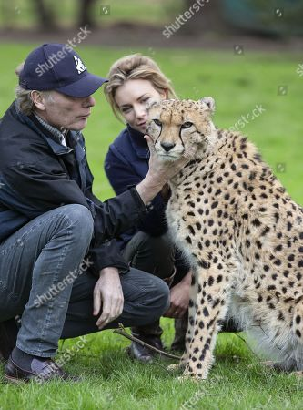 Damian Aspinall and Victoria Aspinall with the Cheetah Saba within the enclosure.