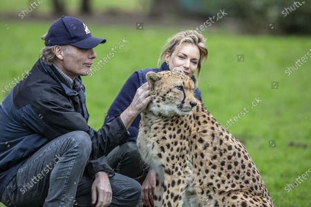 Damian Aspinall and Victoria Aspinall inside the enclosure with Cheetah brother Saba within the enclosure.