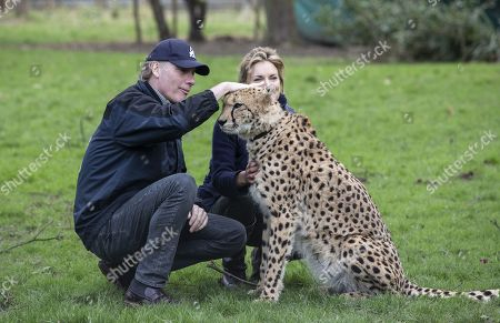 Stock Picture of Damian Aspinall and Victoria Aspinall with the Cheetah Saba within the enclosure.