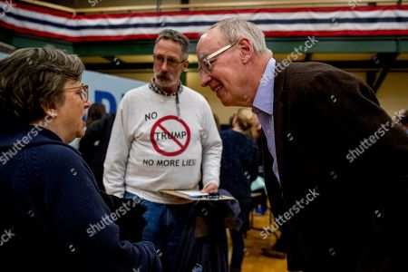 """Bruce Mann, Michael Ward. Warren campaign volunteer Michael Ward of Nashua, N.H., wears a shirt that reads """"No Trump No More Lies!"""" as he waits to speak to Bruce Mann, right, the husband of Democratic presidential candidate Sen. Elizabeth Warren, D-Mass., at a campaign stop at Nashua Community College, in Nashua, N.H"""