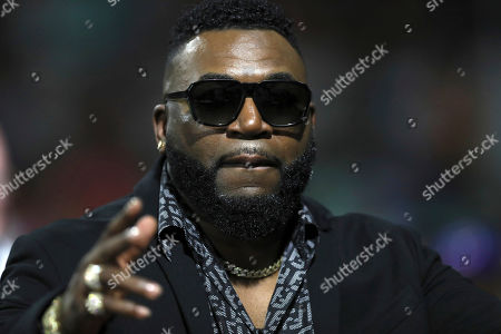 Retired Boston Red Sox player David Ortiz of the Dominican Republic, affectionately known as Big Papi, greets supporters before the start of a Caribbean Series baseball game between Dominican Republic and Puerto Rico, in San Juan, Puerto Rico