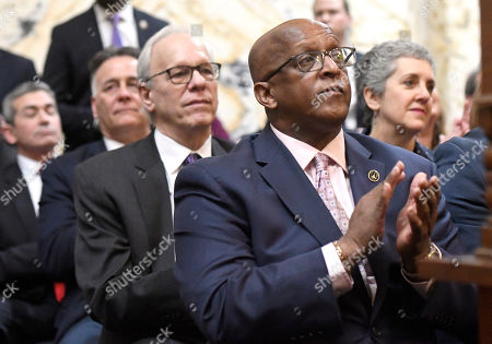 "Stock Image of Baltimore Mayor Bernard ""Jack"" Young applauds before Maryland Gov. Larry Hogan, not pictured, delivers his annual State of the State address to a joint session of the legislature in Annapolis, Md., . Hogan called crime in Baltimore an ""urgent crisis"" during his speech"