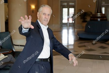 Stock Photo of Fred Wilpon, principal owner of the New York Mets, waves as he heads to a meeting during MLB baseball owners meetings, in Orlando, Fla
