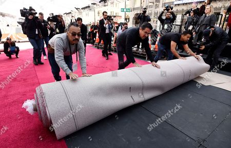 Pascual Rosas, Rudy Morales, Pablo Cruz. Crew workers Pascual Rosas, from left, Rudy Morales and Pablo Cruz roll out the red carpet for Sunday's 92nd Academy Awards at the Dolby Theatre, in Los Angeles