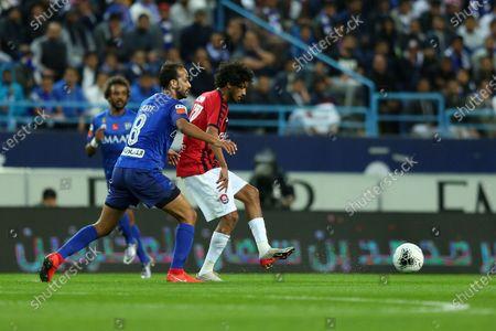 Al-Hilal's Abdullah otayf (L) in action against AL- Raed's Ahmed Al Zaein (R) during the Saudi Professional League soccer match between Al-Hilal and Al-Raed at King Saud University Stadium, Riyadh, Saudi Arabia, 05 February 2020.