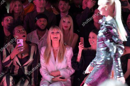 Leslie Jones, Heidi Klum, and Rachel Bilson in the front row