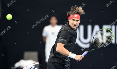 David Ferrer of Spain in action during an exhibition match against Rafa Nadal of Spain for the inauguration of the 'Rafa Nadal Academy' at Shaikh Jaber Al Abdullah Al Jaber Al Sabah International Tennis Complex in Kuwait City, Kuwait, 05 February 2020.