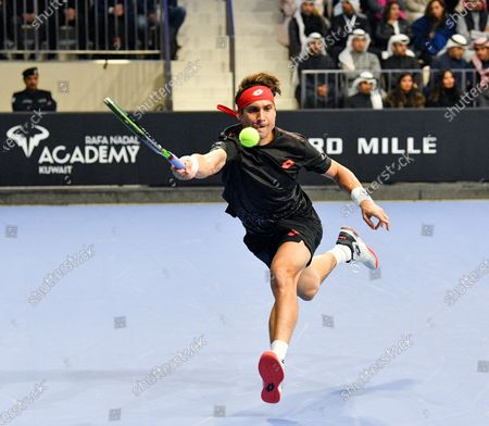 Stock Image of David Ferrer of Spain in action during an exhibition match against Rafa Nadal of Spain for the inauguration of the 'Rafa Nadal Academy' at Shaikh Jaber Al Abdullah Al Jaber Al Sabah International Tennis Complex in Kuwait City, Kuwait, 05 February 2020.