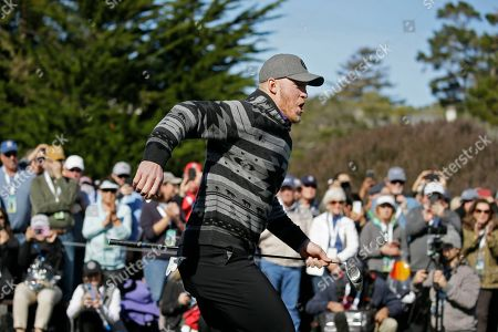Minnesota Vikings' Kyle Rudolph runs to greet Josh Duhamel on the first tee of the Pebble Beach Golf Links during the celebrity challenge event of the AT&T Pebble Beach National Pro-Am golf tournament, in Pebble Beach, Calif
