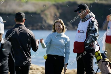 Kira K. Dixon, Nick Faldo, Josh Duhamel. Kira K. Dixon is greeted by Josh Duhamel, left, after making a close shot onto the 17th green of the Pebble Beach Golf Links as Nick Faldo, right, looks on during the celebrity challenge event of the AT&T Pebble Beach National Pro-Am golf tournament, in Pebble Beach, Calif