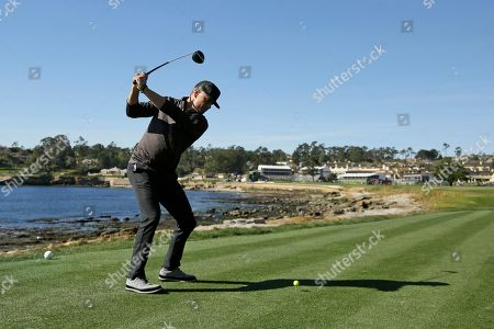 Josh Duhamel hits from the 18th tee of the Pebble Beach Golf Links during the celebrity challenge event of the AT&T Pebble Beach National Pro-Am golf tournament, in Pebble Beach, Calif