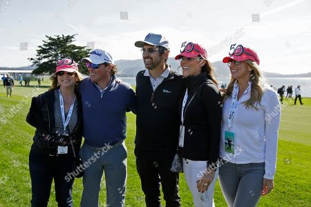 Clay Walker, Ray Romano. Clay Walker, second from left, and Ray Romano, center, pose with a group of women celebrating a 50th birthday on the 18th fairway of the Pebble Beach Golf Links during the celebrity challenge event of the AT&T Pebble Beach National Pro-Am golf tournament, in Pebble Beach, Calif