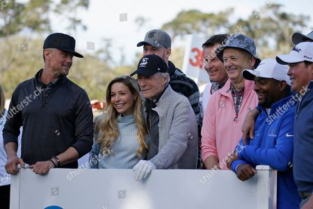 Josh Duhamel, Kira K. Dixon, Clint Eastwood, Kyle Rudolph, Nick Faldo, Bill Murray, Alfonso Ribeiro, Clay Walker. From left, Josh Duhamel, Kira K. Dixon, Clint Eastwood, Kyle Rudolph, Nick Faldo, Bill Murray, Alfsono Ribeiro and Clay Walker pose on the first tee of the Pebble Beach Golf Links before the start of the celebrity challenge event of the AT&T Pebble Beach National Pro-Am golf tournament, in Pebble Beach, Calif