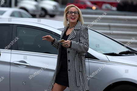 Sen. Kyrsten Sinema, D-Ariz., departs after the impeachment acquittal of President Donald Trump, on Capitol Hill, in Washington