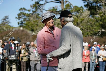 Bill Murray, left, talks with Clint Eastwood on the first tee of the Pebble Beach Golf Links during the celebrity challenge event of the AT&T Pebble Beach National Pro-Am golf tournament, in Pebble Beach, Calif