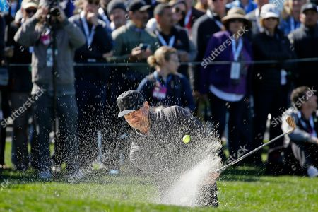 Josh Duhamel hits out of a bunker onto the second green of the Pebble Beach Golf Links during the celebrity challenge event of the AT&T Pebble Beach National Pro-Am golf tournament, in Pebble Beach, Calif
