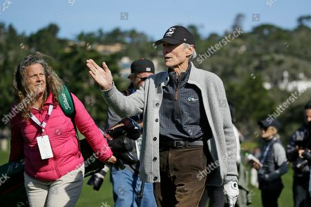 Clint Eastwood gestures walking down the third fairway of the Pebble Beach Golf Links during the celebrity challenge event of the AT&T Pebble Beach National Pro-Am golf tournament, in Pebble Beach, Calif