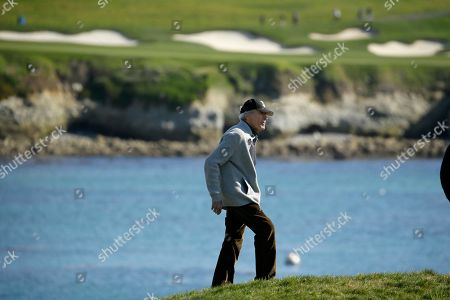 Clint Eastwood walks up to the 17th green of the Pebble Beach Golf Links during the celebrity challenge event of the AT&T Pebble Beach National Pro-Am golf tournament, in Pebble Beach, Calif