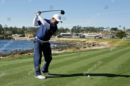 Alfonso Ribeiro hits from the 18th tee of the Pebble Beach Golf Links during the celebrity challenge event of the AT&T Pebble Beach National Pro-Am golf tournament, in Pebble Beach, Calif