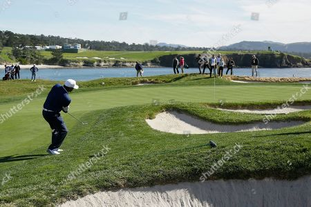 Alfonso Ribeiro chips the ball onto the 17th green of the Pebble Beach Golf Links during the celebrity challenge event of the AT&T Pebble Beach National Pro-Am golf tournament, in Pebble Beach, Calif