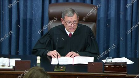 Stock Image of In this image from United States Senate television, Chief Justice of the US John G Roberts Jnr, Jr. presides as the US Senate votes to acquit US President Trump of all charges brought by the US House of Representatives in their two articles of impeachment in the US Senate in the US Capitol