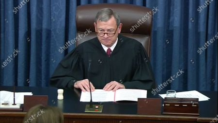 In this image from United States Senate television, Chief Justice of the US John G Roberts Jnr, Jr. presides as the US Senate votes to acquit US President Trump of all charges brought by the US House of Representatives in their two articles of impeachment in the US Senate in the US Capitol