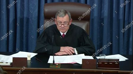 Stock Picture of In this image from United States Senate television, Chief Justice of the US John G Roberts Jnr, Jr. presides after the US Senate voted to acquit US President Trump of all charges brought by the US House of Representatives in their two articles of impeachment in the US Senate in the US Capitol