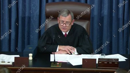 In this image from United States Senate television, Chief Justice of the US John G Roberts Jnr, Jr. reads some acknowledgements after the US Senate voted to acquit US President Trump of all charges brought by the US House of Representatives in their two articles of impeachment in the US Senate in the US Capitol