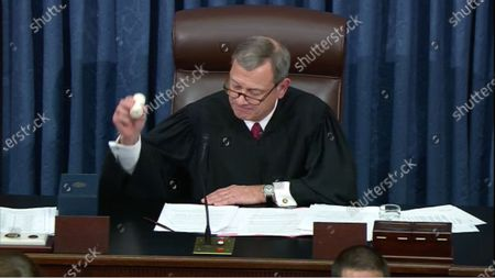Stock Photo of In this image from United States Senate television, Chief Justice of the US John G Roberts Jnr, Jr. adjourns the court of impeachment after the US Senate voted to acquit US President Trump of all charges brought by the US House of Representatives in their two articles of impeachment in the US Senate in the US Capitol
