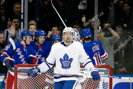 Toronto Maple Leafs' Cody Ceci (83) reacts as the New York Rangers celebrates a goal by Filip Chytil during the first period of an NHL hockey game, in New York