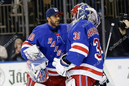 New York Rangers goaltender Igor Shesterkin (31) is congratulated by Henrik Lundqvist (30) after an NHL hockey game against the Toronto Maple Leafs, in New York. The Rangers won 5-3