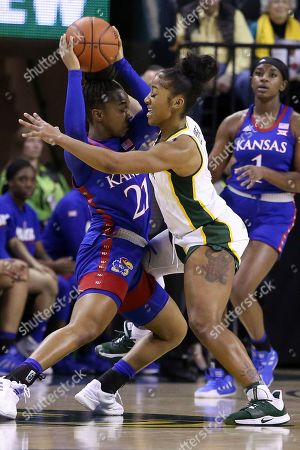 Baylor guard Te'a Cooper (4) pressures Kansas guard Brooklyn Mitchell (21) as she looks to pass in the second half of an NCAA college basketball game, in Waco, Texas