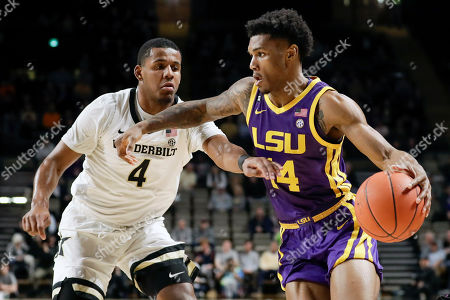 Marlon Taylor, Jordan Wright. LSU guard Marlon Taylor (14) drives against Vanderbilt's Jordan Wright (4) in the first half of an NCAA college basketball game, in Nashville, Tenn