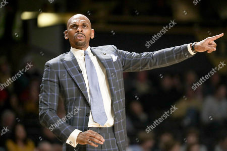 Vanderbilt head coach Jerry Stackhouse directs his players in the first half of an NCAA college basketball game against LSU, in Nashville, Tenn