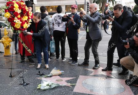 A person signs a card at a memorial on the Hollywood Star of US actor Kirk Douglas on the Hollywood Walk of Fame in Hollywood, California, USA, 05 February 2020. According to media reports, US actor Kirk Douglas died at the age of 103 on 05 February 2020.