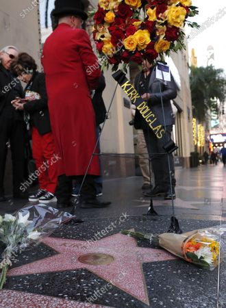 Flowers are placed on the Hollywood Star of US actor Kirk Douglas on the Hollywood Walk of Fame in Hollywood, California, USA, 05 February 2020. According to media reports, US actor Kirk Douglas died at the age of 103 on 05 February 2020.