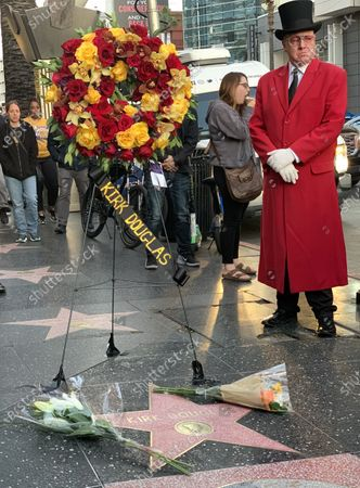 Gregg Donovan, also known as the 'Ambassador of Hollywood' stands by the Hollywood Star of US actor Kirk Douglas on the Hollywood Walk of Fame in Hollywood, California, USA, 05 February 2020. According to media reports, US actor Kirk Douglas died at the age of 103 on 05 February 2020.