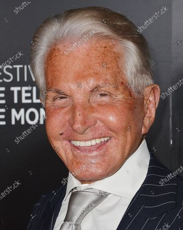George Hamilton and guest
