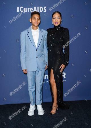 Kiyan Carmelo Anthony, left, and Lala Anthony attend the amfAR Gala New York AIDS research benefit at Cipriani Wall Street, in New York