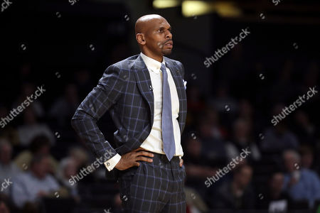 Vanderbilt head coach Jerry Stackhouse watches the action in the first half of an NCAA college basketball game against LSU, in Nashville, Tenn