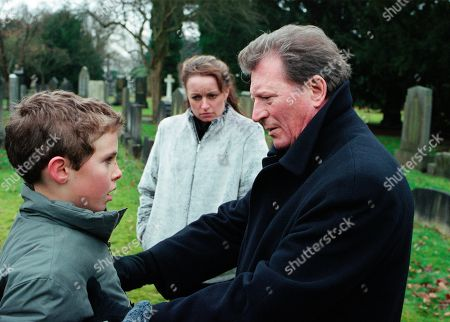 Stock Photo of Ep 4987 Friday 16th February 2001 Susan Barlow's funeral takes place with Mike turning up uninvited. Blaming Mike for her death, Ken accuses him of hounding Susan to get Adam, who finds it all too much and runs crying from the graveside. Mike stops him and tells him that he is his father. Adam punches him. With Linda Baldwin, as played by Jacqueline Pirie ; Adam Barlow, as played by Iain De Caestecker ; Mike Baldwin, as played by Johnny Briggs.