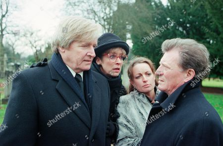 Stock Image of Ep 4987 Friday 16th February 2001 Susan Barlow's funeral takes place with Mike turning up uninvited. Blaming Mike for her death, Ken accuses him of hounding Susan to get Adam, who finds it all too much and runs crying from the graveside. Mike stops him and tells him that he is his father. Adam punches him. With Ken Barlow, as played by William Roache ; Deirdre Rachid, as played by Anne Kirkbride ; Linda Baldwin, as played by Jacqueline Pirie ; Mike Baldwin, as played by Johnny Briggs.