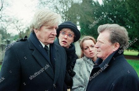 Ep 4987 Friday 16th February 2001 Susan Barlow's funeral takes place with Mike turning up uninvited. Blaming Mike for her death, Ken accuses him of hounding Susan to get Adam, who finds it all too much and runs crying from the graveside. Mike stops him and tells him that he is his father. Adam punches him. With Ken Barlow, as played by William Roache ; Deirdre Rachid, as played by Anne Kirkbride ; Linda Baldwin, as played by Jacqueline Pirie ; Mike Baldwin, as played by Johnny Briggs.