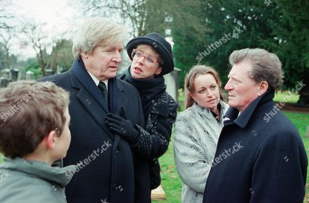 Stock Picture of Ep 4987 Friday 16th February 2001 Susan Barlow's funeral takes place with Mike turning up uninvited. Blaming Mike for her death, Ken accuses him of hounding Susan to get Adam, who finds it all too much and runs crying from the graveside. Mike stops him and tells him that he is his father. Adam punches him. With Ken Barlow, as played by William Roache ; Deirdre Rachid, as played by Anne Kirkbride ; Linda Baldwin, as played by Jacqueline Pirie ; Adam Barlow, as played by Iain De Caestecker ; Mike Baldwin, as played by Johnny Briggs.