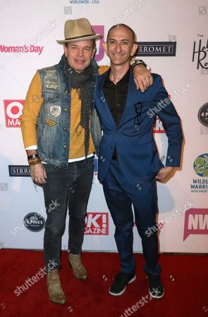 """Stock Picture of Paul Oakenfold, DJ Crash. Paul Oakenfold, left, and DJ Crash arrive at the """"LA Loves OZ"""" Charity Event at the Roosevelt Hotel, in Los Angeles"""