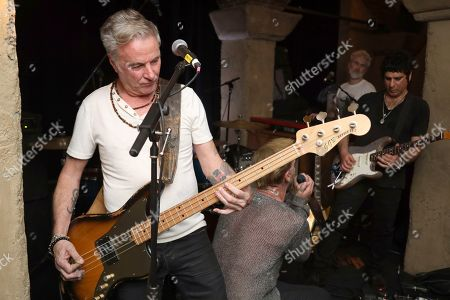 "Stock Photo of Garry Gary Beers, Ashenmoon. Garry Gary Beers, former member and bass player of Australian rock band INXS and current member of the rock band Ashenmoon, left, performs live on stage at the ""LA Loves OZ"" Charity Event at the Roosevelt Hotel, in Los Angeles"