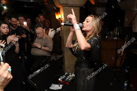 "Stock Image of Taylor Dayne performs live on stage at the ""LA Loves OZ"" Charity Event at the Roosevelt Hotel, in Los Angeles"