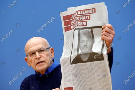 German journalist Guenter Wallraff shows a paper clipping during a press conference calling for the release of activist Julian Assange, in Berlin, Germany, 06 February 2020. Politicians of various parties have started an initiative to demand the release of the Wikileaks founder from his extradition custody in the United Kingdom. The hearing about his delivery to the United States will take place this month.