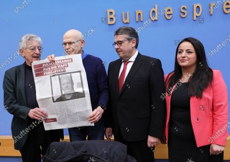 German journalist Guenter Wallraff (2-L) shows a paper clipping next to the former leader of the Social Democratic Party (SPD), Sigmar Gabriel (C), the former German Minister of Interior, Gerhart Baum (L) and the member of the Left Party in Bundestag, Sevim Dagdelen (R), during a press conference calling for the release of activist Julian Assange, in Berlin, Germany, 06 February 2020. Politicians of various parties have started an initiative to demand the release of the Wikileaks founder from his extradition custody in the United Kingdom. The hearing about his delivery to the United States will take place this month.